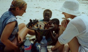 Marie and H playing chess with the wee boys from down the beach.