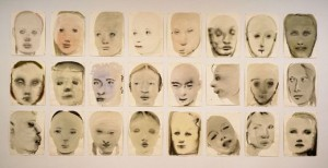 A series of ink on paper heads by Marlene Dumas